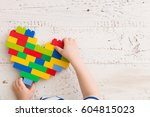 top  view  on child's hands... | Shutterstock . vector #604815023