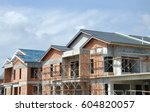 facade of two story luxury... | Shutterstock . vector #604820057