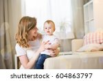 mom with a baby eleven months... | Shutterstock . vector #604863797