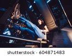 sportive woman using weights... | Shutterstock . vector #604871483
