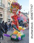 Small photo of Acireale (CT), Italy - February 28, 2017: small allegorical float, depicting a burlesque dancer, during the carnival parade along the streets of Acireale.