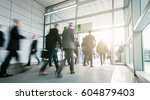 business people walking in a... | Shutterstock . vector #604879403