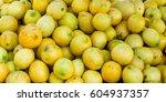 pile of lemons for sale at... | Shutterstock . vector #604937357
