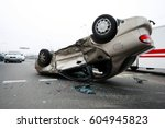 car turned over after  accident. | Shutterstock . vector #604945823