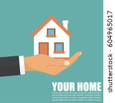 hand of an agent with home in a ... | Shutterstock .eps vector #604965017