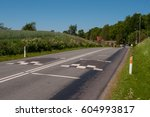 Speed Bump On A Road Between...