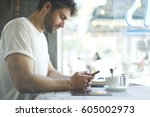 cropped image bearded hipster...   Shutterstock . vector #605002973