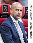 Small photo of NETHERLANDS, AMSTERDAM - 13th August 2016: Ajax coach, trainer, manager Peter Bosz at the Amsterdam ArenA