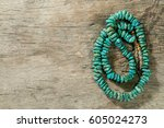 turquoise necklace on wooden... | Shutterstock . vector #605024273