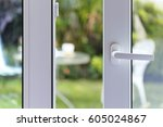 open door of a family home.... | Shutterstock . vector #605024867