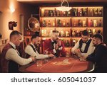 group of men playing poker in... | Shutterstock . vector #605041037