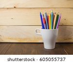a cup of pencils   pens on... | Shutterstock . vector #605055737
