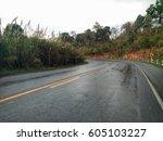 wet road landscape under cloudy ... | Shutterstock . vector #605103227