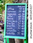 coffee menu hand written in... | Shutterstock . vector #605165327
