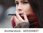 vaper girl smokes electric... | Shutterstock . vector #605204837