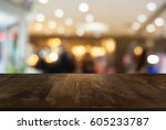 empty dark wood table top and... | Shutterstock . vector #605233787