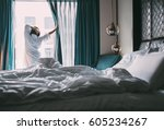 woman meets rainy morning in... | Shutterstock . vector #605234267