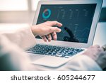 business women reviewing data... | Shutterstock . vector #605244677