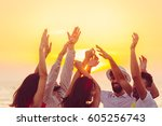 people dancing at the beach... | Shutterstock . vector #605256743