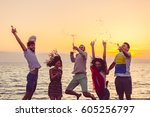 young people dancing on beach... | Shutterstock . vector #605256797