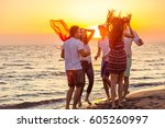 young people dancing on beach... | Shutterstock . vector #605260997