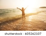 happy woman at the sea at... | Shutterstock . vector #605262107