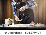 a man preparing a pizza  knead... | Shutterstock . vector #605279477