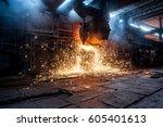 pouring of liquid metal in open ... | Shutterstock . vector #605401613