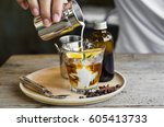 cold brew coffee on wooden... | Shutterstock . vector #605413733