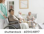 young nurse and disabled woman... | Shutterstock . vector #605414897