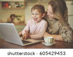 mother with daughter using... | Shutterstock . vector #605429453