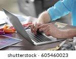 fashion designer working at... | Shutterstock . vector #605460023