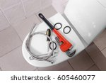 Small photo of Plumber's tools on toilet at home