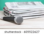 microphone with newspaper on... | Shutterstock . vector #605522627