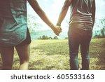 both women and men are walking... | Shutterstock . vector #605533163