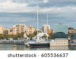 Small photo of Affluence on display with luxurious yachts & sailboat moored in waterfront spaces. Condos with a view to marina in Barcelona. Cars parked at nearby exhibits under tents. Tour the world with a yacht.