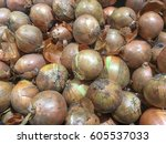holland onion in the market | Shutterstock . vector #605537033