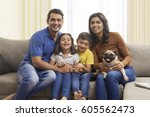 parents with son and daughter... | Shutterstock . vector #605562473