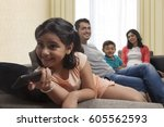 smiling girl watching tv with... | Shutterstock . vector #605562593