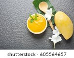 fresh mango smoothie bowl on... | Shutterstock . vector #605564657