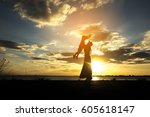 silhouette of mother and kid.... | Shutterstock . vector #605618147