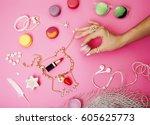 woman hands holding macaroons...   Shutterstock . vector #605625773