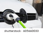 close up of electric car being... | Shutterstock . vector #605660033