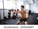 young fit hispanic man in gym... | Shutterstock . vector #605666897