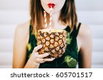 woman drinking juice from... | Shutterstock . vector #605701517