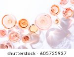 Stock photo many glasses of rose wine at wine tasting concept of rose wine and variety white background top 605725937
