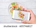 hands taking photo vegan... | Shutterstock . vector #605746817