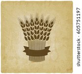 sheaf of wheat with ribbon...   Shutterstock .eps vector #605751197