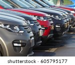 cars in a row on a lot | Shutterstock . vector #605795177