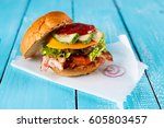 delicious turkey burgers with... | Shutterstock . vector #605803457